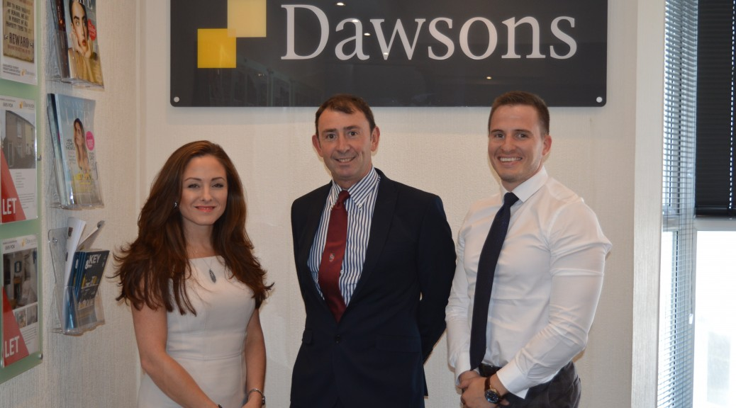L-R Dawsons' Mumbles Branch Manager Emma Bolton, Mumbles RFC Chairman Simon Evans, and Tom Hope of Dawsons' Fine and Country Department
