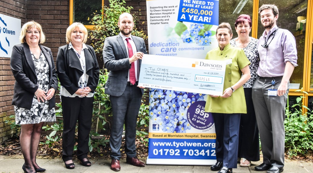 L-R Andrea Devoy, Office Manager at Dawsons' Morriston branch, Tracy Sturgess, Associate at Dawson's Morriston Branch, James Smale, Senior Negotiator at Dawson's Morriston Branch, Delyth Gough, Trustee of Ty Olwen Trust, Helen Murray, Chairman of Ty Olwen Trust, and Dr Owain Thomas