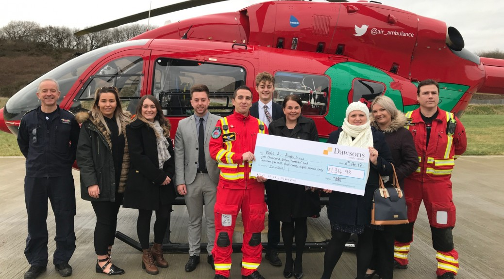 Dawsons hand over cheque to Wales Air Ambulance