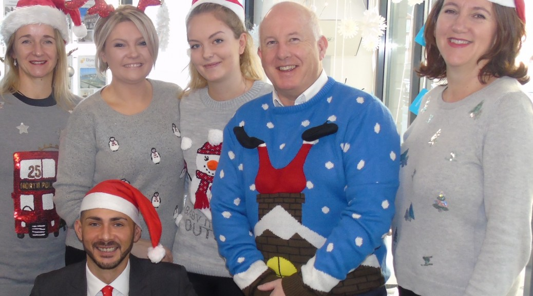 Dawsons staff at the Marina office sporting their Xmas jumpers
