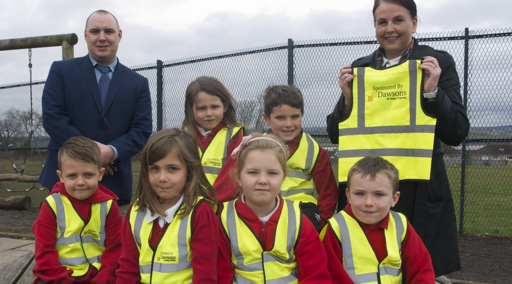 Dawsons present high vis jackets to schoolchildren in Loughor