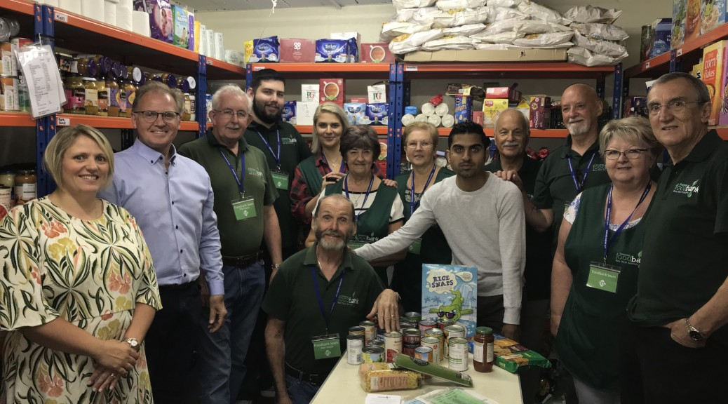 L-R Naomi Webborn, Dawsons' Lettings Department Coordinator, Chris Hope, Dawsons' Senior Partner, and volunteers at Swansea Foodbank at City Church in Dyfatty.