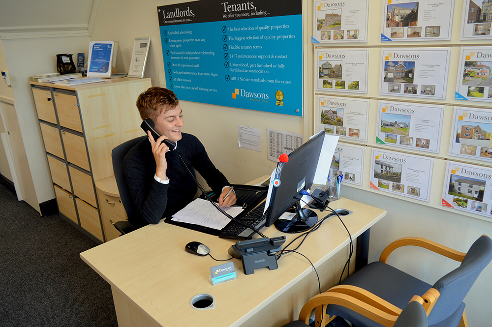 Estate Agent on the Phone to a property seller in Killay Swansea