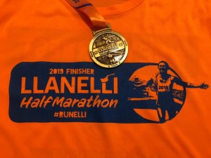 Matthew Whitehead ran the Llanelli half marathon in aid of a sick colleague at Dawsons