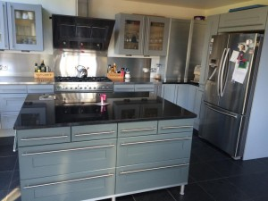 Renovate by repainting the kitchen doors to add new life to old units